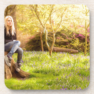 Young cool woman relaxing at spring time coaster