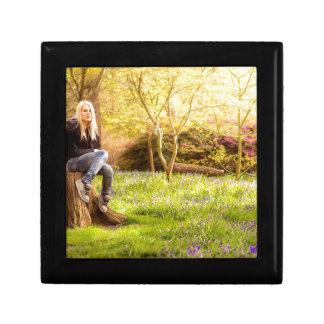 Young cool woman relaxing at spring time gift box