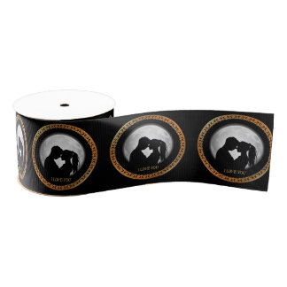 Young couple black silhouette kissing one another grosgrain ribbon