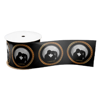 Young couple black silhouette kissing one another satin ribbon