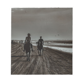 Young Couple Riding Horses at the Beach Notepad