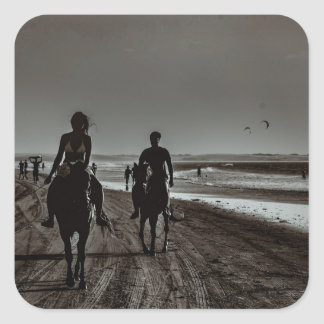 Young Couple Riding Horses at the Beach Square Sticker