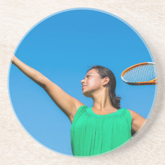 Young dutch woman with tennis racket and ball coaster