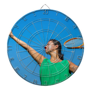 Young dutch woman with tennis racket and ball dartboard