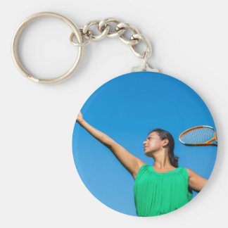Young dutch woman with tennis racket and ball keychain