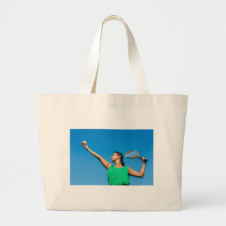 Young dutch woman with tennis racket and ball large tote bag
