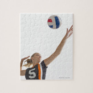 Young girl (16-17) playing volleyball jigsaw puzzle