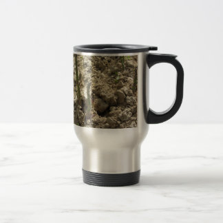 Young green asparagus sprouting from the ground travel mug