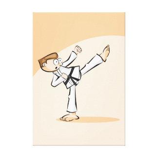 Young karate raising the leg with decición canvas print