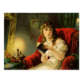 Young lady reading by candlelight is spooked postcard