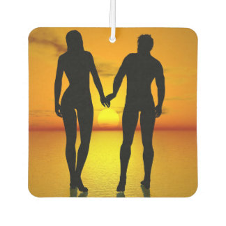 Young lovers by sunset car air freshener