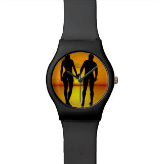 Young lovers by sunset watch