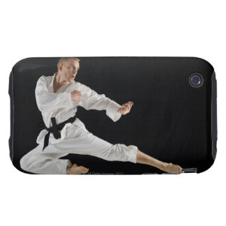 Young man performing karate kick on black tough iPhone 3 covers