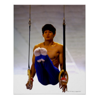 Young man practicing gymnastic rings poster