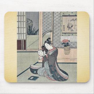 Young man striking a drum by Suzuki, Harunobu Mousepad