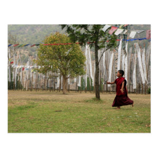 Young monk and prayer flags postcard