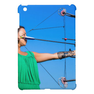Young woman aiming arrow of compound bow cover for the iPad mini