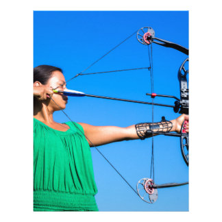 Young woman aiming arrow of compound bow letterhead