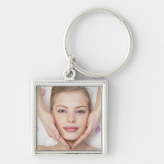 Young woman getting massage keychains