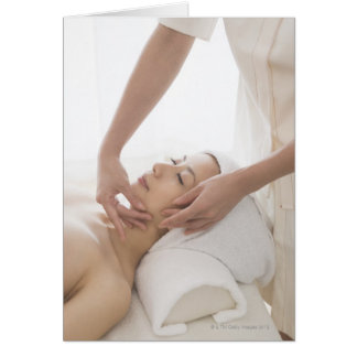 Young woman having facial massage card