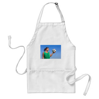 Young woman holding football on hand with blue sky standard apron