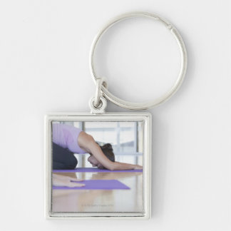 young woman in the downward dog position during Silver-Colored square keychain