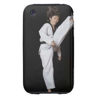 Young woman performing front kick tough iPhone 3 cases