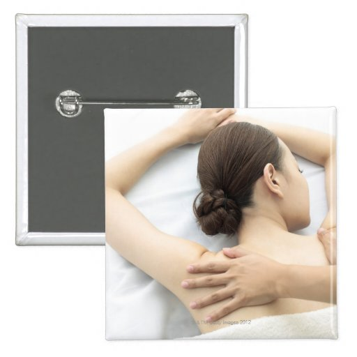 young woman receiving massage,woman in health 2 pinback buttons