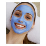 Young woman wearing facial mask, smiling, poster