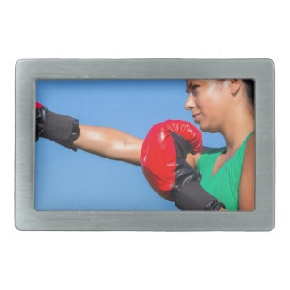 Young woman wearing red boxing gloves blue sky belt buckles