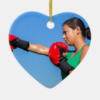 Young woman wearing red boxing gloves blue sky ceramic heart ornament