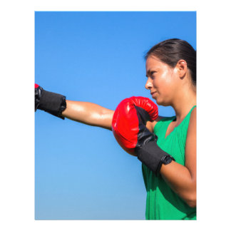 Young woman wearing red boxing gloves blue sky letterhead