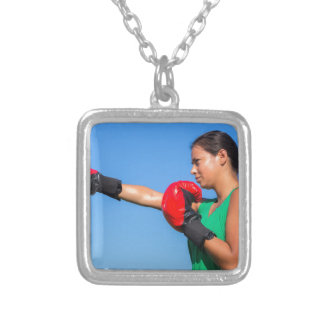 Young woman wearing red boxing gloves blue sky silver plated necklace