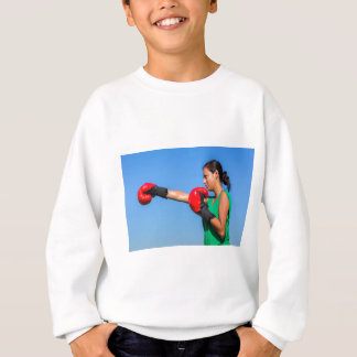 Young woman wearing red boxing gloves blue sky sweatshirt