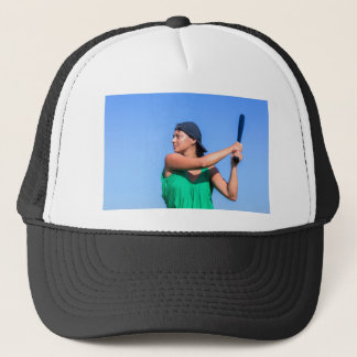 Young woman with baseball bat and cap