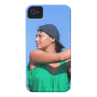 Young woman with baseball bat and cap Case-Mate iPhone 4 cases