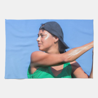 Young woman with baseball bat and cap kitchen towel