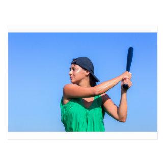Young woman with baseball bat and cap postcard