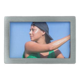 Young woman with baseball bat and cap rectangular belt buckles