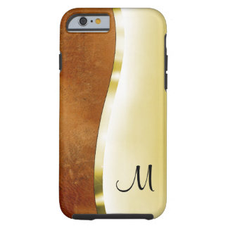 Your initial on this beautiful gold and leather tough iPhone 6 case