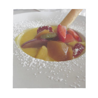 Zabaglione cream with fresh fruit and rolled wafer notepads