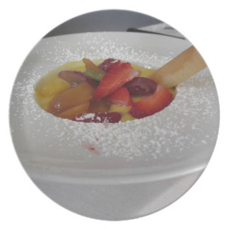 Zabaglione cream with fresh fruit and rolled wafer plate