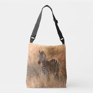 Zebra foal in morning light crossbody bag