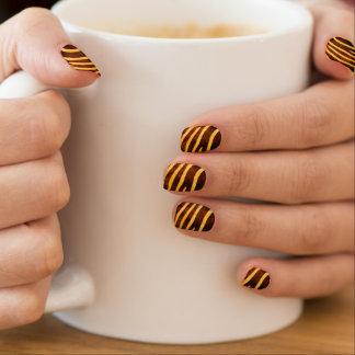 Zebra hide print in black and orange nail art