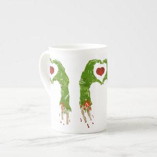 zombie hand making heart tea cup