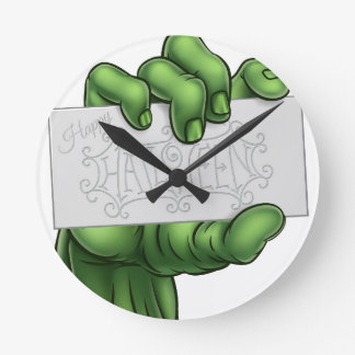 Zombie Monster Hand Holding Happy Halloween Sign Round Clock