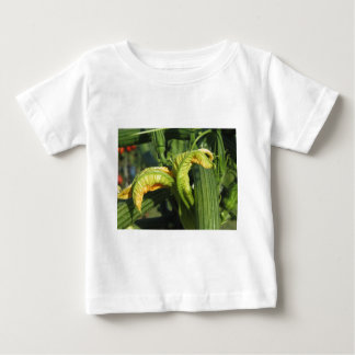 Zucchini plant in blossom in the vegetable garden baby T-Shirt